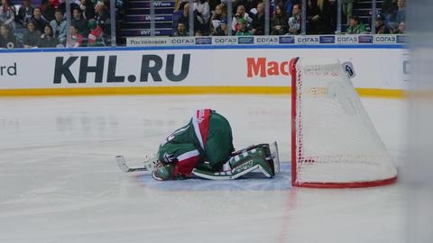 goalkeeper in uniform near gate at hockey match on arena 動画素材, ムービー映像素材