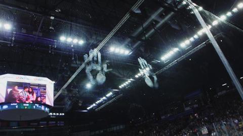 child handprints on clear plastic screen near hockey arena GIF