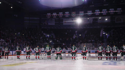 hockey teams on ice arena focus changes to blur slow motion GIF
