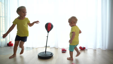 Hyperactive kids boy and girl playing at home. Gimbal motion GIF