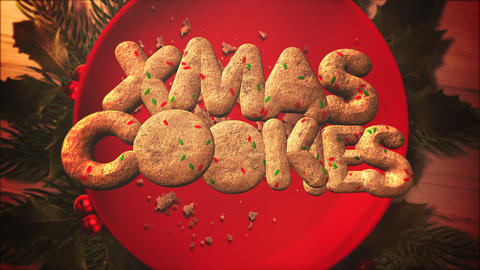 Animated closeup XMas text, candy and Christmas pie on wood background Animation