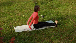 High angle view of sporty woman doing pilates exercise outdoors ビデオ