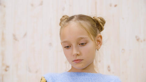 Portrait of beautiful upset little girl looking down ビデオ