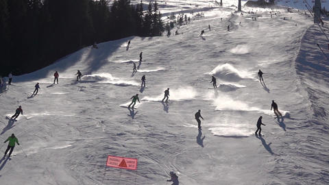 Sunny Winter Slope with Many Skiers. Slow Motion GIF
