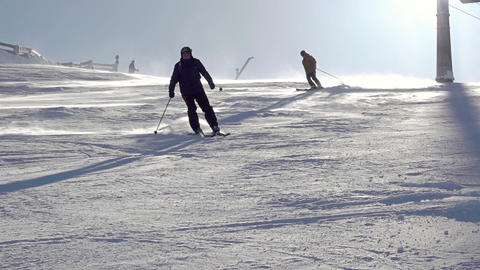Skier Makes a Turn on a Sunny Slope. Slow Motion GIF