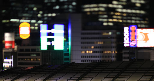 A night cityscape at the business town in Tokyo tilt shift ビデオ