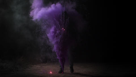 A man in a hat stands at night in the middle of purple smoke Magician ビデオ