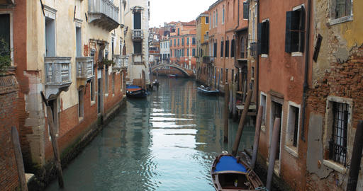 Boats float on back canals in Venice Italy. Shot filmed in 4k 2160p Footage