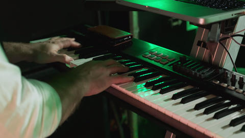 Male hands play music on the piano at a concert. Playing the electronic piano ビデオ