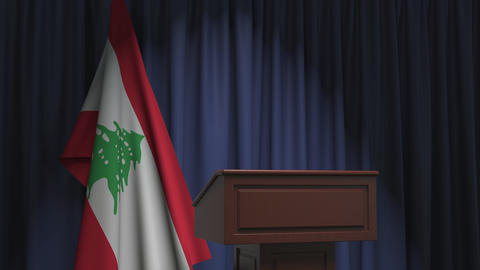 Flag of Lebanon and speaker podium tribune. Political event or statement related Live Action