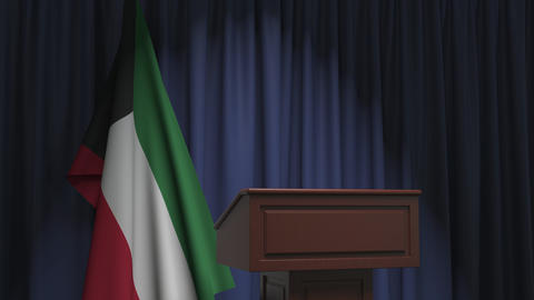 Flag of Kuwait and speaker podium tribune. Political event or statement related Live Action