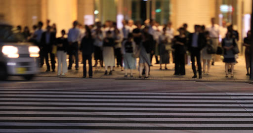 A night cityscape of walking people at the business town in Tokyo ライブ動画