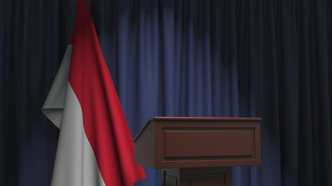 Flag of Indonesia and speaker podium tribune. Political event or statement Live Action