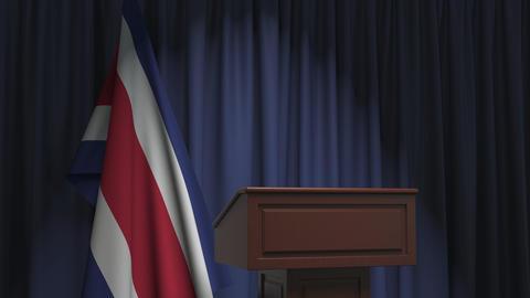 Flag of Costa Rica and speaker podium tribune. Political event or statement Live Action