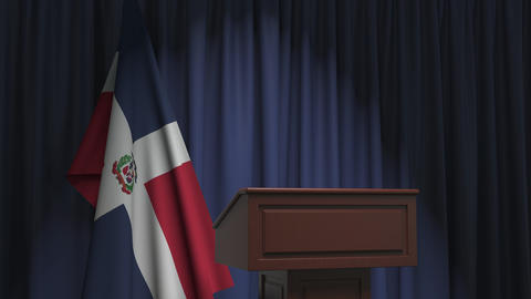 Flag of the Dominican Republic and speaker podium tribune. Political event or Live Action