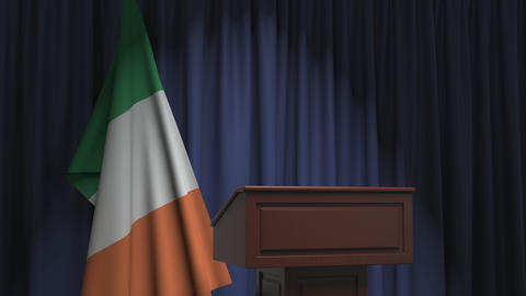 Flag of the Republic of Ireland and speaker podium tribune. Political event or Live Action