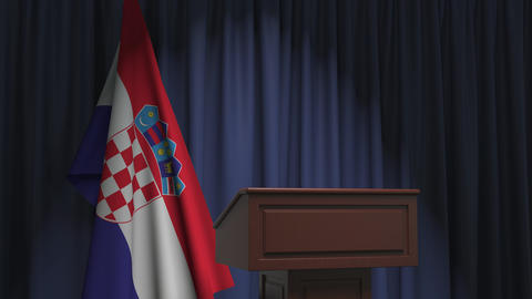 Flag of Croatia and speaker podium tribune. Political event or statement related Live Action