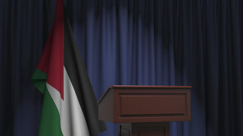 Flag of Jordan and speaker podium tribune. Political event or statement related Live Action