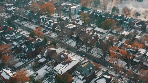 Aerial establishing shot of a Toronto neighborhood after a snowfall ビデオ