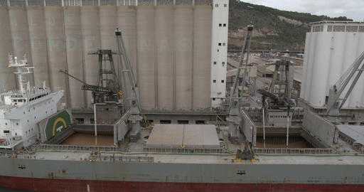 Aeial view. Loading of grain on a ship. Port. Cargo ship Live Action