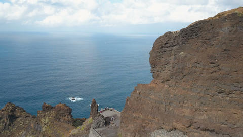 Aerial view of steep cliffs over Atlantic Ocean. Flight over people admiring ビデオ