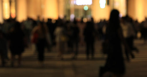 A night cityscape of walking people at the business town in Tokyo defocused GIF