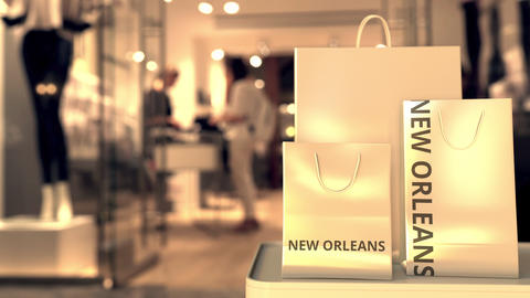 Shopping bags with NEW ORLEANS text against blurred store. American retail GIF