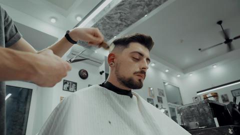 The client falls asleep during a haircut. Having fun in a barbershop ビデオ
