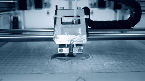 3D printer printing an object from plastic Live Action