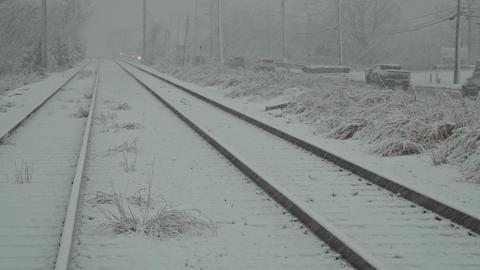 NY USA January 13, 2019: Car snowy road at city street during heavy snowfall in ビデオ