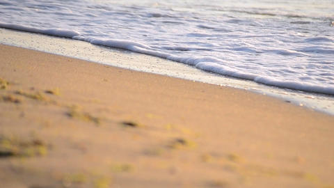 Yellow sand and clear water sea ocean beach in the morning Live Action