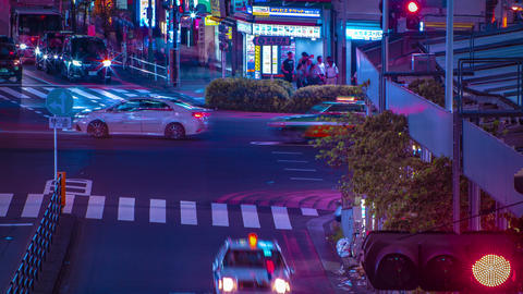 A night timelapse of the neon street in Shinjuku Tokyo high angle long shot tilt Footage