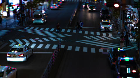 A night timelapse of the neon street in Shinjuku Tokyo high angle tiltshift zoom Footage