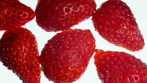 Closeup 4k video of lotd of ripe strawberries squeezing and filling the screen Archivo