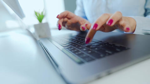 Female hands with bright manicure typing on a laptop keyboard Footage