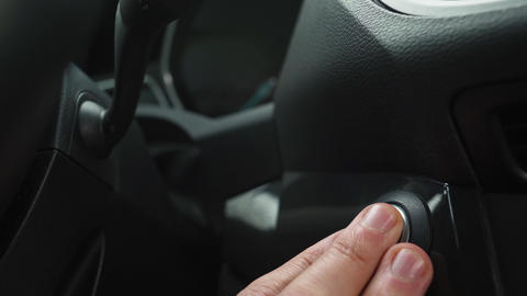 Male hand pushes engine start stop button in a modern car interior Footage