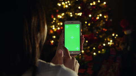 Woman using vertical smartphone with green screen Footage