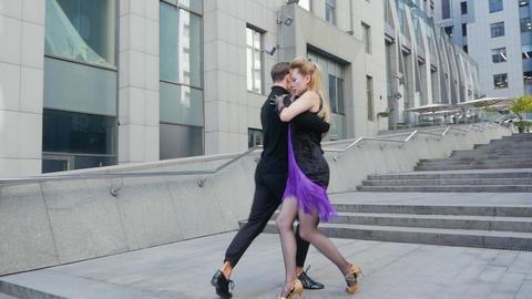 Happy couple dancing street GIF