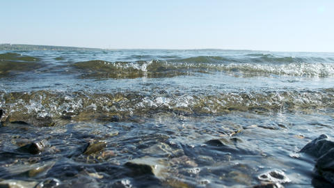 Sea waves on the shore, close-up. Clear water in the sea, natural marine oceanic Footage