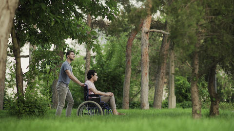 A person helping to a disabled man. Man is taking care of disabled and helping Live Action