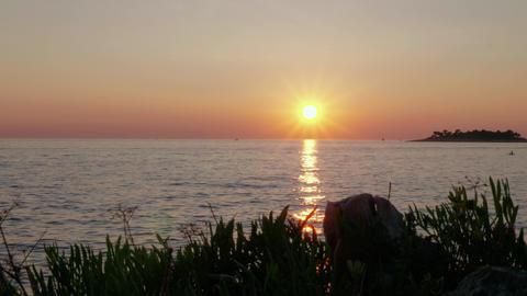 Colorful sea sunset sky and island, sailing boat silhouette GIF
