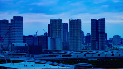 A dusk timelapse of the cityscape at the urban street in Ariake Tokyo long shot Footage