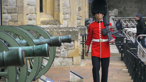 British guard in traditional red-black uniform Live Action