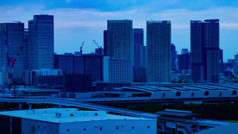 A dusk timelapse of the cityscape at the urban street in Ariake Tokyo long shot Live Action