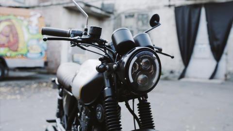 Pan shot of motorbike in neon light sity, urban background. Custom modern bike Live Action
