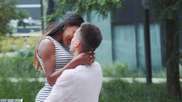 Cheerful mixed-race couple enjoying their time together outdoors Live Action
