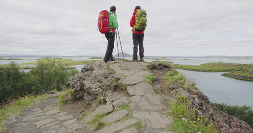 Hiking people looking at view on hike on Iceland Live Action