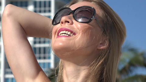 Smiling Woman Wearing Sunglasses Live Action