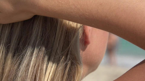 Blonde Woman Touching Her Hair Footage