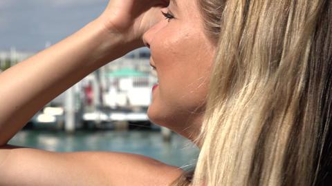 Smiling Blonde Woman at Marina Footage
